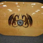 Customized inlaid design for teak boat table