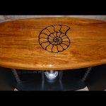 Cockpit table with carved teak inlay