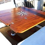 Folding-leaf teak cockpit table with inlaid design