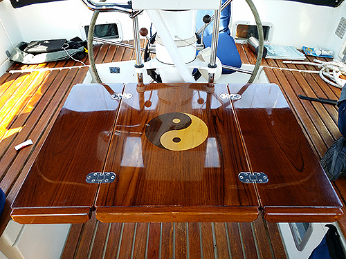 Cockpit dining table with inlaid design