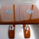Teak sailboat cockpit table with inlaid granite stars