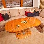 Boat cabin dining table with teak inlaid designs