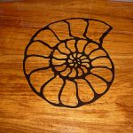 Carved teak inlaid design