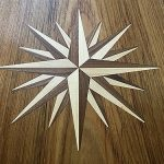Inlaid compass rose for teak dining table